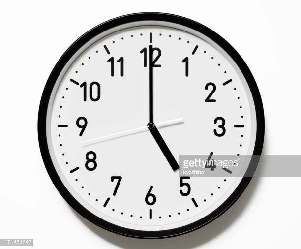 Isolated shot of 5 O'Clock clock face on white background