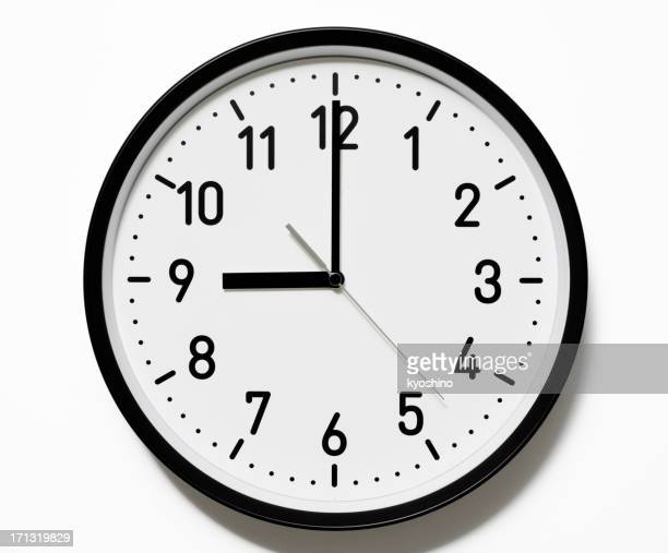 Isolated shot of 9 O'Clock clock face on white background