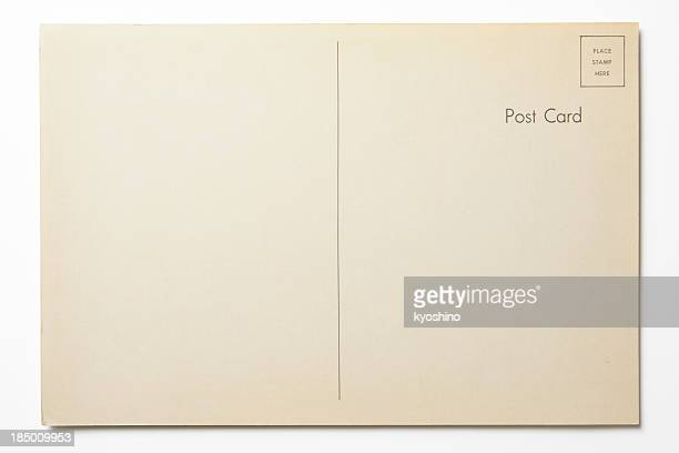 isolated shot of antique postcard on white background - postcard stock pictures, royalty-free photos & images