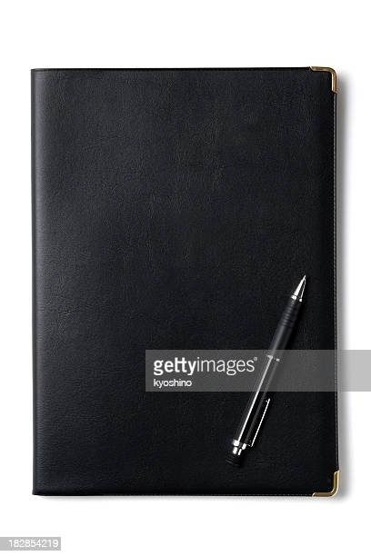 Isolated shot of black notebook with pen on white background