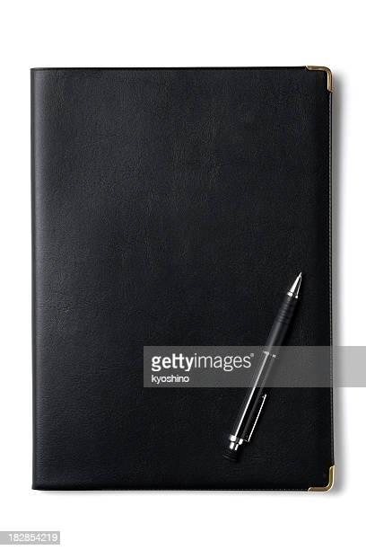Aislado negro portátil con foto de un bolígrafo sobre fondo blanco