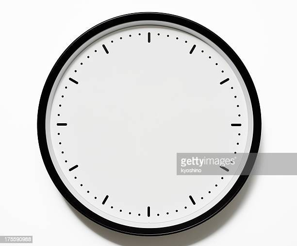 isolated shot of blank clock face on white background - klok stockfoto's en -beelden