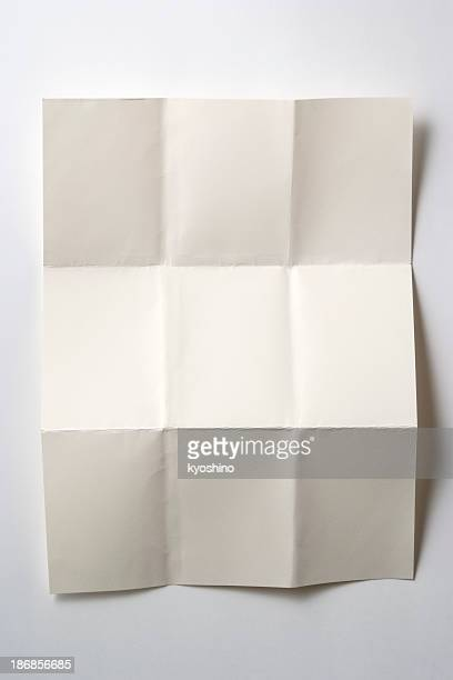 isolated shot of blank folded paper on white background - folded stock photos and pictures