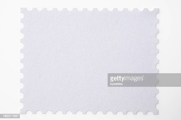 Isolated shot of blank postage stamp on white background