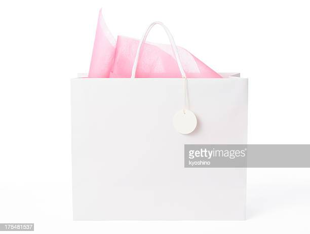 Isolated shot of  blank shopping bag with tag on white