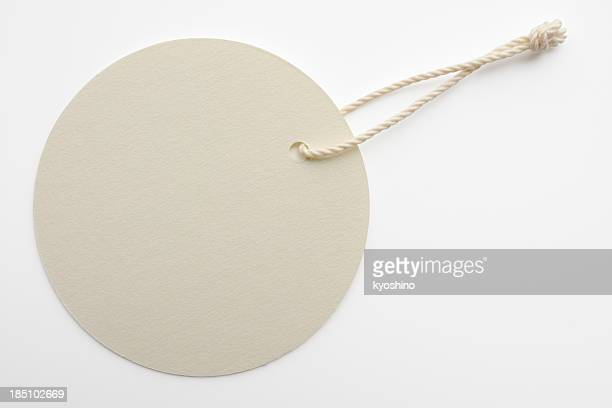 Isolated shot of blank white round tag on white background