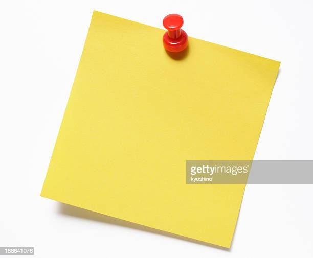 Isolated shot of blank yellow sticky note with red thumbtack