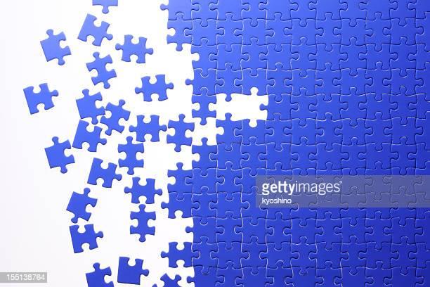 Isolated shot of blue Jigsaw puzzle on white background