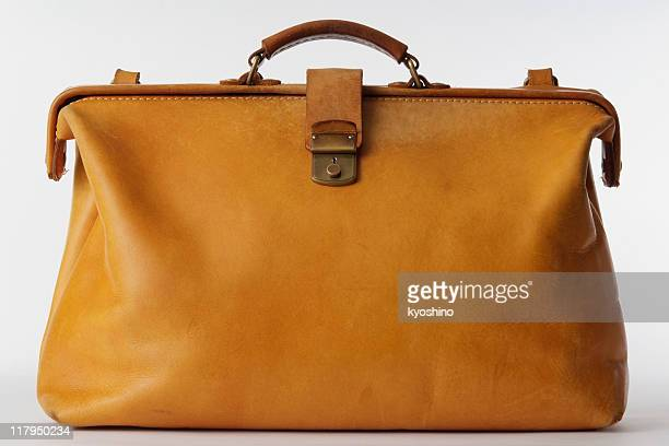 Isolated shot of brown leather bag on white background