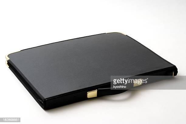 Isolated shot of closed black portfolio on white background