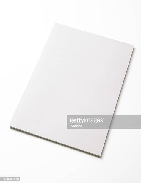 Isolated shot of closed blank magazine on white background