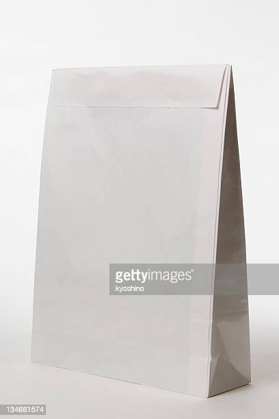 Isolated shot of closed blank paper bag on white background