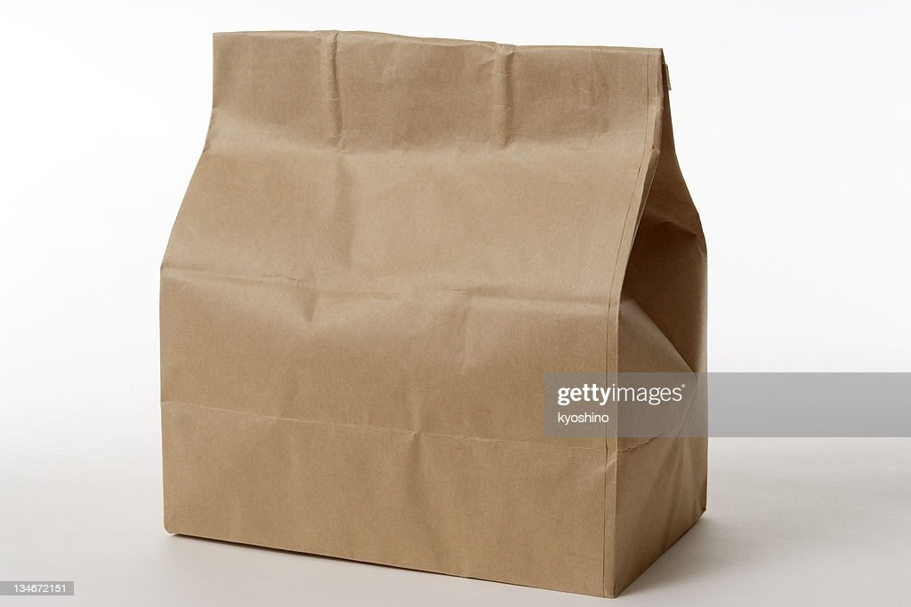 Isolated shot of closed brown paper bag on white background : Stock Photo