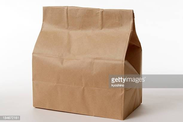 isolated shot of closed brown paper bag on white background - take away food stock pictures, royalty-free photos & images