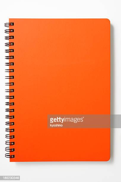 Isolated shot of closed red spiral notebook on white background