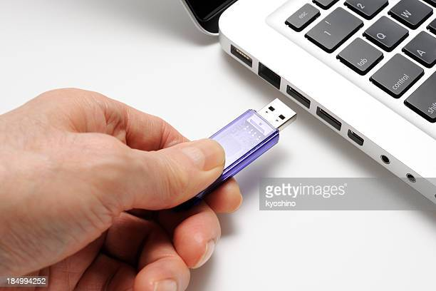Isolated shot of connecting USB flash drive on white background