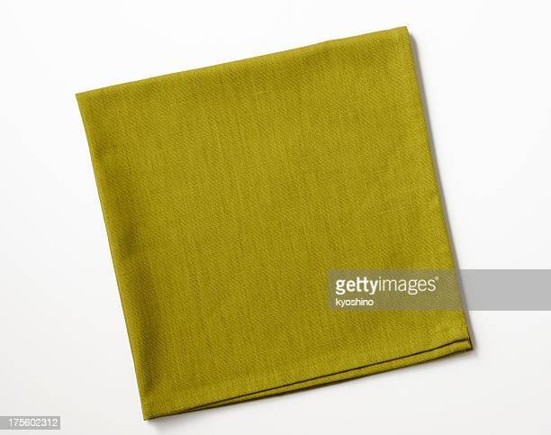 Isolated shot of folded green napkin on white background
