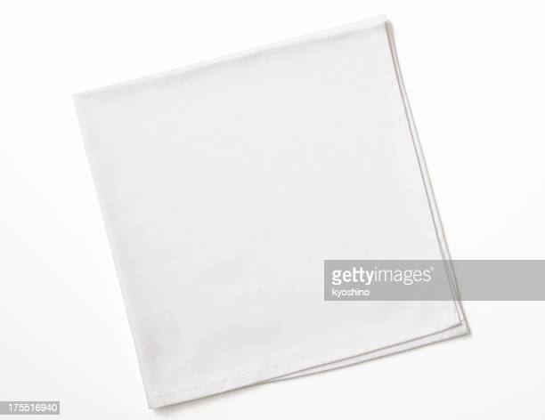 isolated shot of folded white napkin on white background - textile stock pictures, royalty-free photos & images