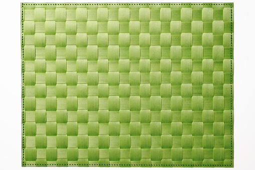 Isolated shot of green bamboo place mat on white background 174958229