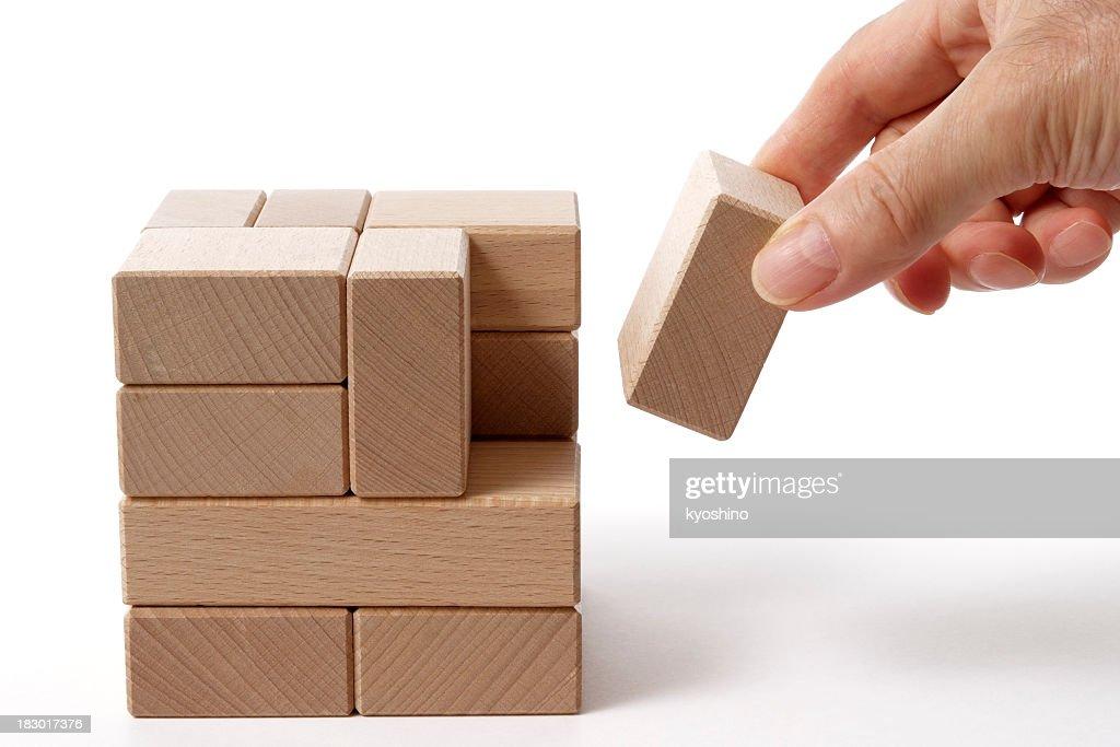 Isolated shot of holding a wood block on white background : Stock Photo