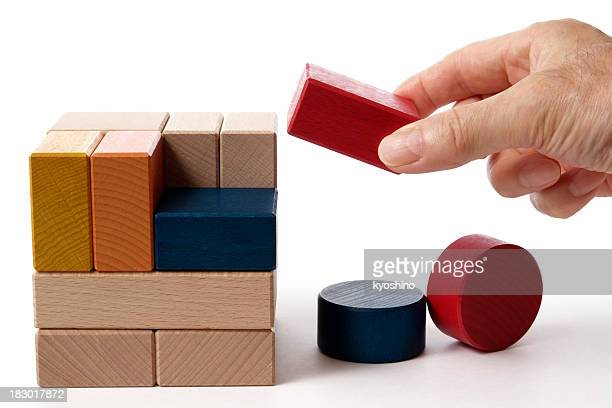Isolated shot of holding a wood block on white background