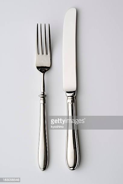 isolated shot of knife and fork on white background - silverware stock pictures, royalty-free photos & images