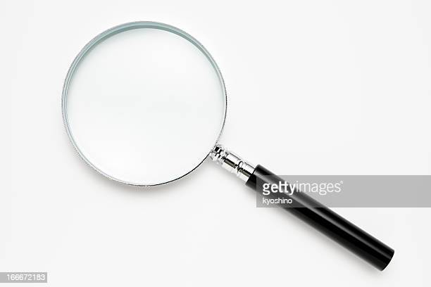 isolated shot of magnifying glass on white background - lens optical instrument stock pictures, royalty-free photos & images
