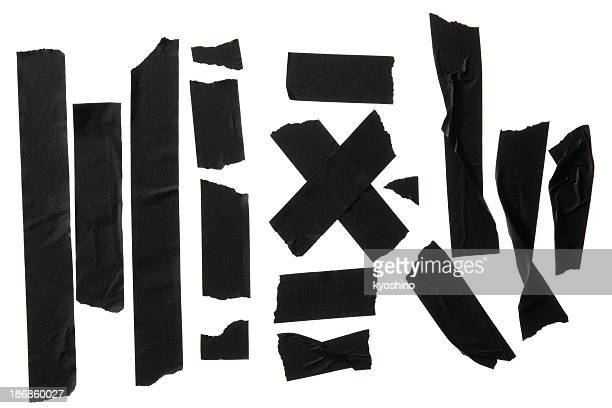 Isolated shot of many torn adhesive tape on white background