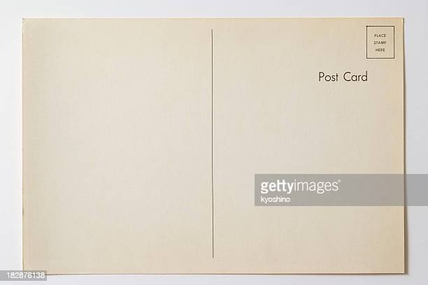 isolated shot of old blank post card on white background - typography stock photos and pictures