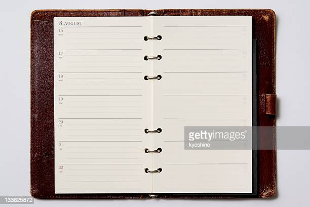 isolated shot of opened blank personal organizer on white background - diary stock pictures, royalty-free photos & images