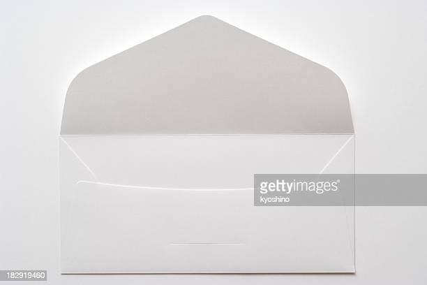 Isolated shot of opened white envelope on white background