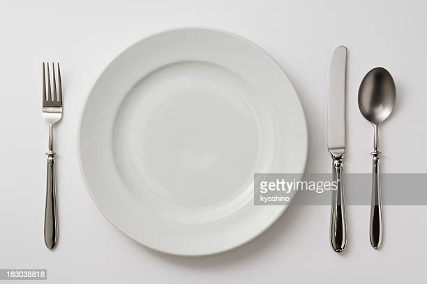 isolated shot of plate with cutlery on white background - silverware stock pictures, royalty-free photos & images