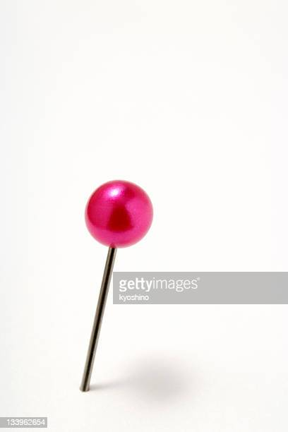Isolated shot of red pushpin on white background