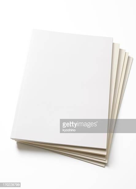 Isolated shot of stacked blank magazine on white background