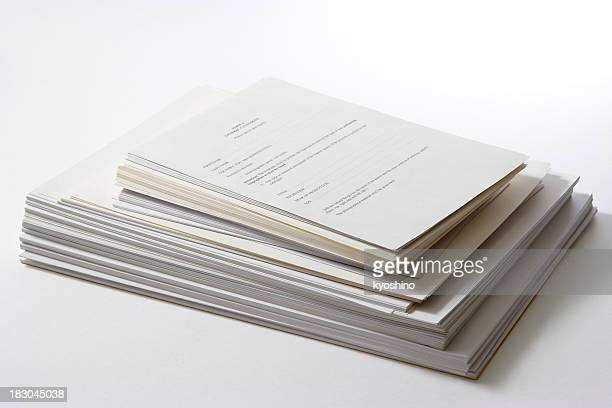 Isolated shot of stacked documents on white background