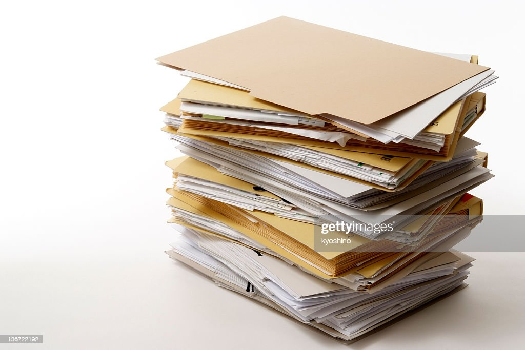 Isolated shot of stacked file folders on white background : Stock Photo