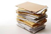 Isolated shot of stacked file folders on white background