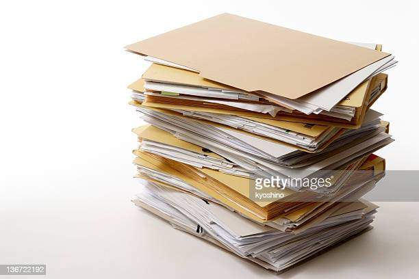 isolated shot of stacked file folders on white background - heap stock pictures, royalty-free photos & images