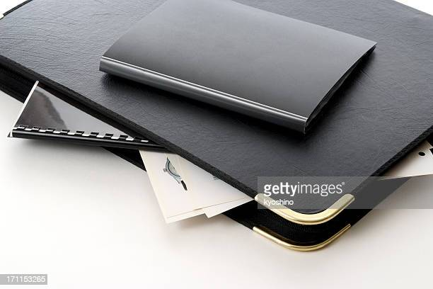 Isolated shot of stacked portfolio on white background