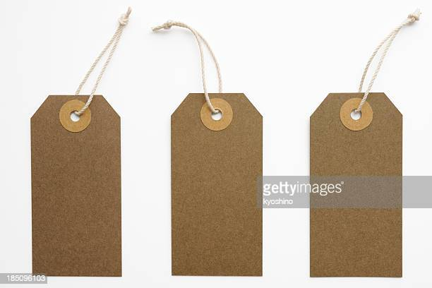 Isolated shot of three blank brown tags on white background