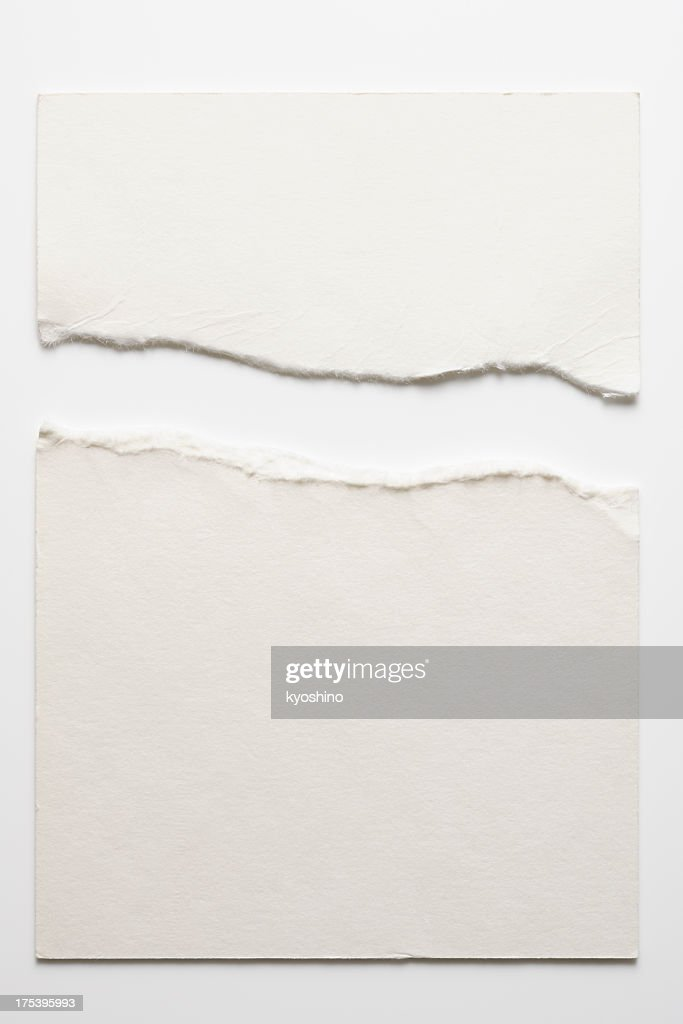 Isolated shot of torn blank white paper on white background : Stock Photo