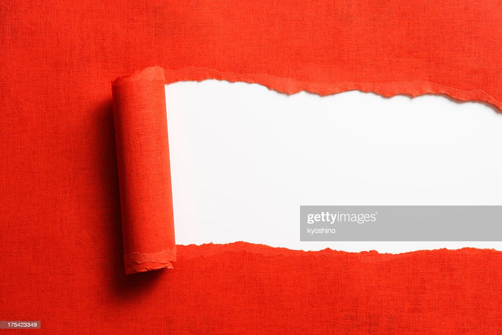 Isolated shot of torn red paper on white background : Stock Photo