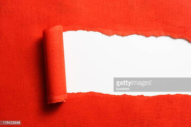 Isolated shot of torn red paper on white background