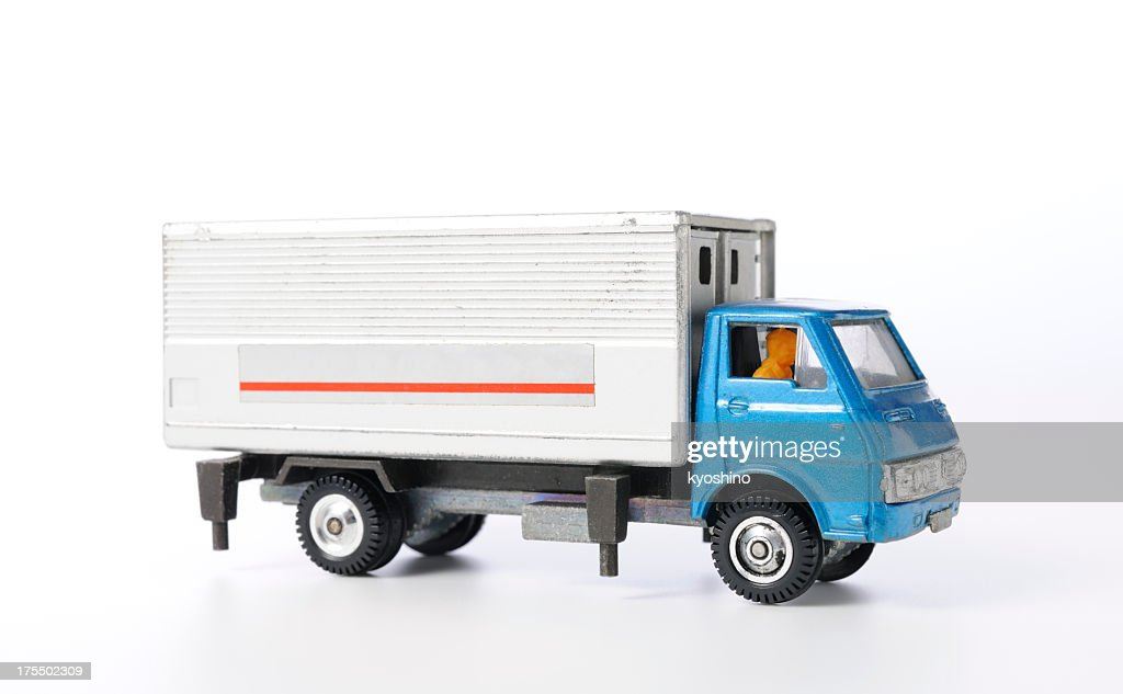 Isolated shot of vintage toy truck on white background : Stock Photo