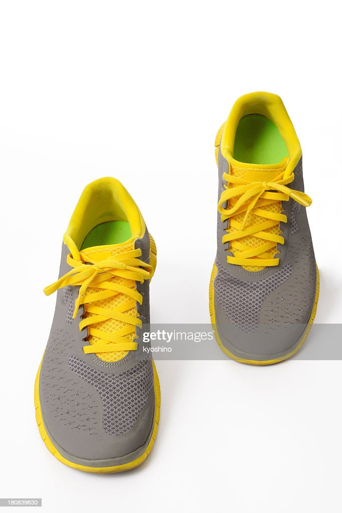 22c22de037d51d Isolated shot of walking yellow sneaker on white background   Stock Photo