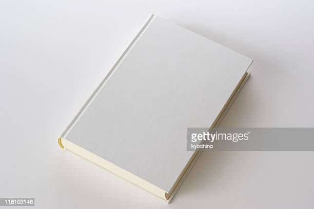 isolated shot of white blank book on white background - boek stockfoto's en -beelden