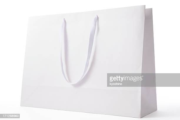 isolated shot of white blank shopping bag on white background - shopping bag stock pictures, royalty-free photos & images