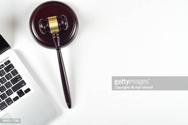 Isolated Top View of Judges Gavel and laptop white Background Copy Space