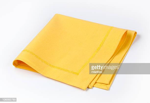 Isolated yellow napkin twice folded on white background