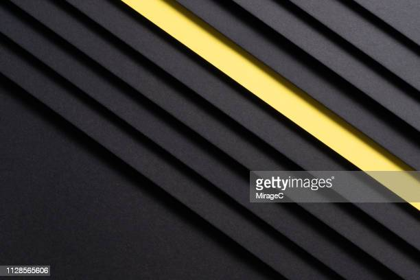 isolated yellow paper in black - tilt stock pictures, royalty-free photos & images
